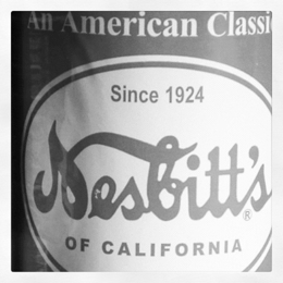 [desaturated image of a Nesbitt's Orange Soda bottle label]